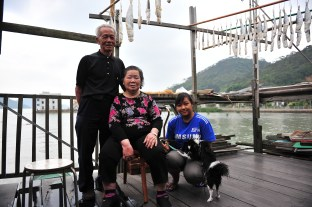 """Together with their domestic helper Ar Yuen, Ho Cho Tai and his wife live happily in Tai O. Ho says, """"Only in Tai O, you can have such fresh air."""""""