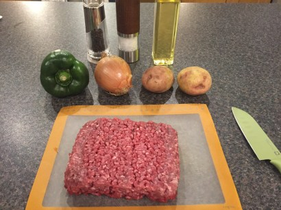 Ingredients for Jo jo meat balls (made with beef, green pepper, potato and egg)