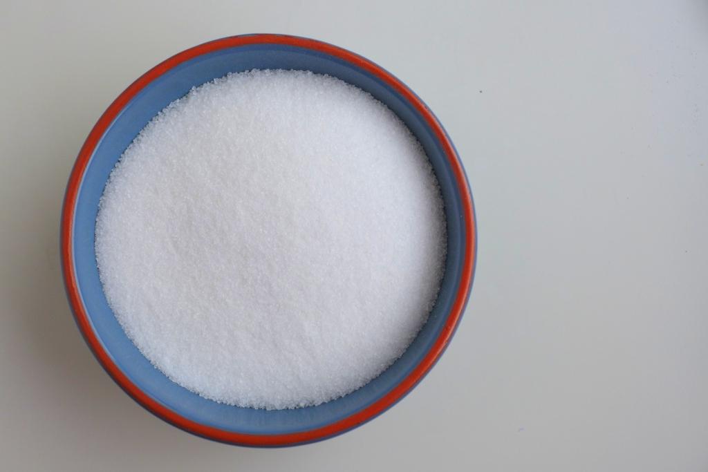 granulated sugar in blue terra cotta dish