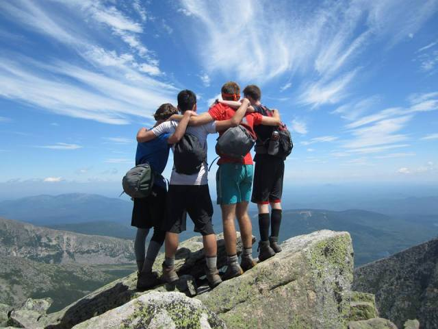Camp Merrowvista Odyssey men celebrate on Mount Katahdin