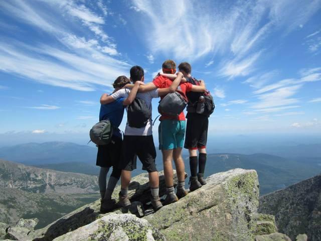 Camp Merrowvista Odyssey men celebrate on Mount Katahdin