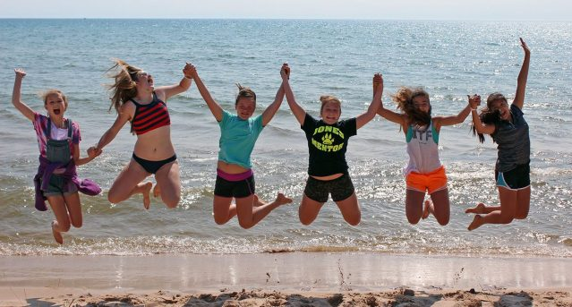 Juniors jump on Lake Michigan beach