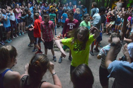 Community sings songs around council circle fire