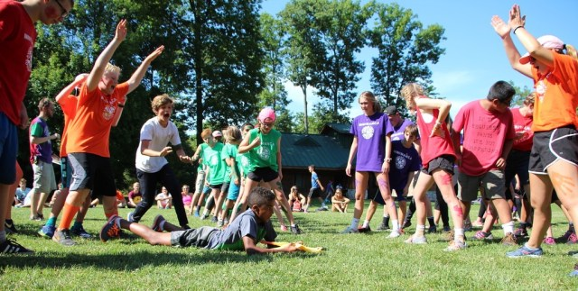 Miniwanca early bird summer campers cheer during steal the bacon