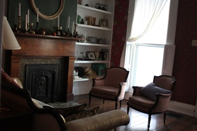 Unfortunately crooked photo of a very sweet room. Book cases on either side of the fireplace.