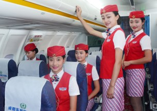 CHENGDU, CHINA - JUNE 14: (CHINA OUT) Prospective flight attendants pose for pictures at Chengdu East Star Airlines College on June 14, 2016 in Chengdu, Sichuan Province of China. 20 prospective flight attendants from Chengdu East Star Airlines College attended a military training including creeping in water, raising logs, combat and wrestling to prepare for dealing with emergency situations on aircraft. (Photo by VCG/VCG via Getty Images)