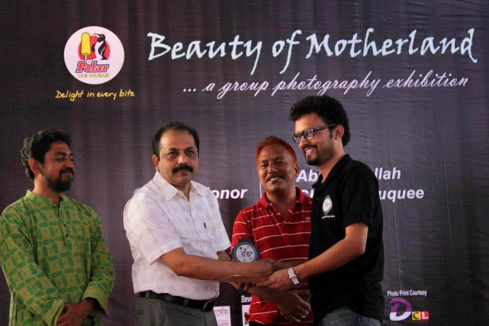 """Receiving """"One of the best photographer's Award""""."""
