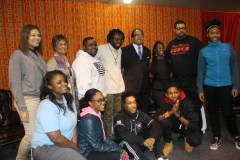 Panelists, Sam P.K. Collins, Dr. Chavis, and Ms. Frances pose with children from the FBR branch of the Boys and Club of Greater Washington