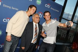 Bob and Mike Bryan taking photos with guests at the D.C. Citi Dining Series