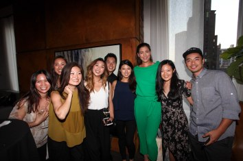 NEW YORK, NY - AUGUST 24: Guests pose for a picture with Garbiñe Muguruza during The Taste Of Tennis Master Class With St Giles Hotels at The Tuscany, A St Giles Signature Hotel on August 24, 2016 in New York City. (Photo by Donald Bowers/Getty Images for St Giles Hotels)