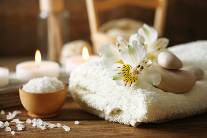 Composition of spa treatment, candles in bowl with water