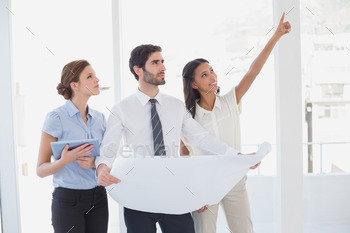 Business team reading a plan in an office