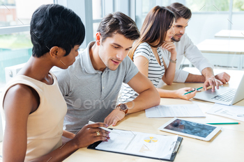 Multiethnic group of people creating business plan in office