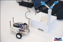 'Cargie' awaits last-minute adjustments before a demonstration in front of Etihad Cargo officials. Cargie is a load-carrying robot that could potentially replace workers in cargo loading bays. It utilizes a camera tracking system to map an area and 'learn' its surroundings. It can be controlled and sent to specific locations using an app. It was developed by NYU Abu Dhabi 2017 graduate Batu Aytemiz.