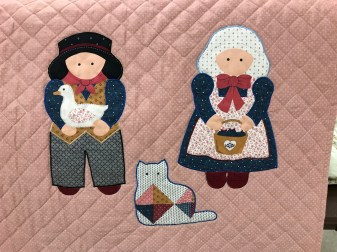 Carol P applique people and cat quilt.