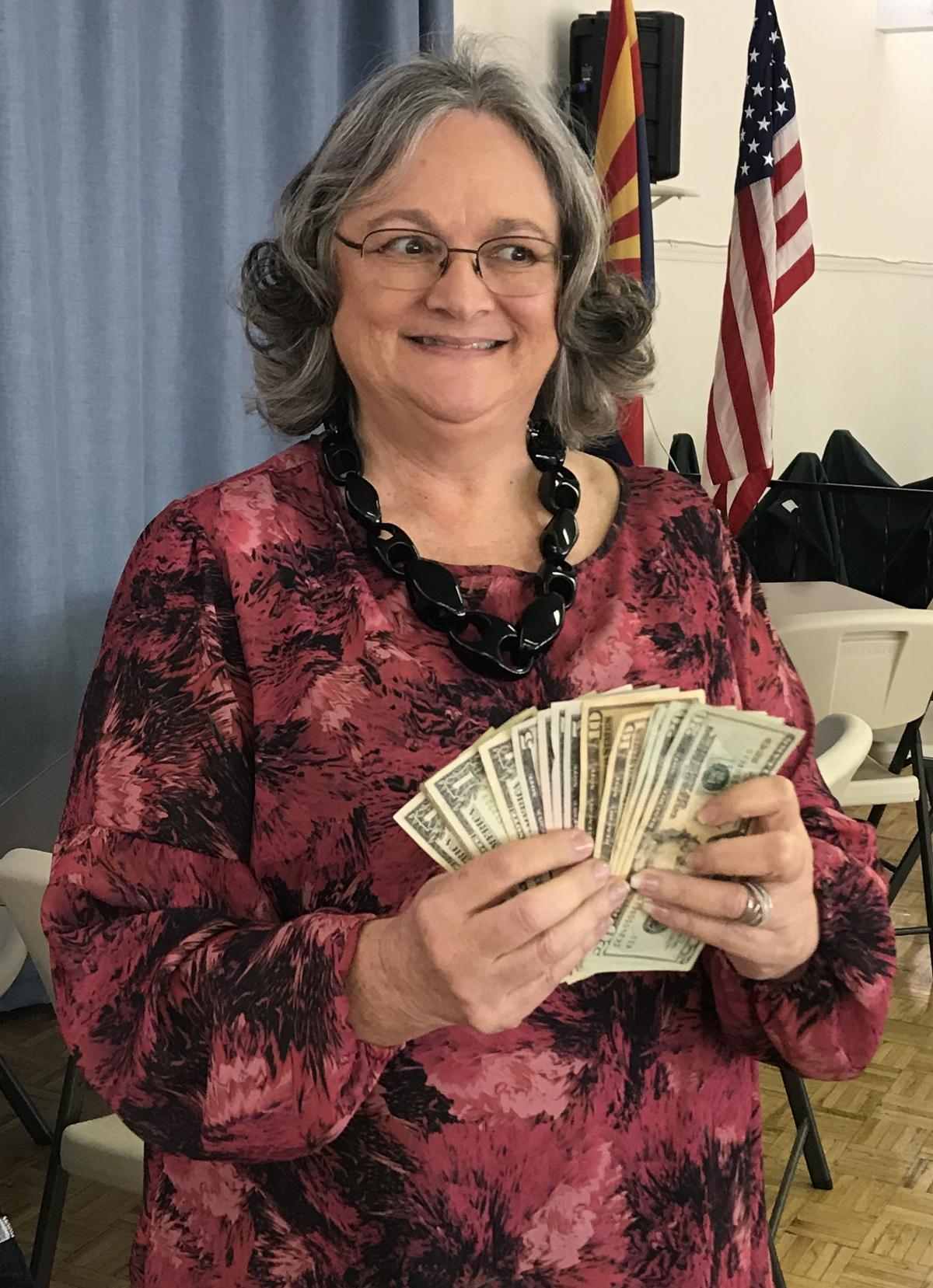 Barbara Davenport wins 50-50
