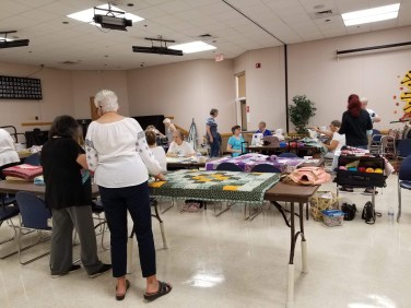 Most of our tying volunteers preparing blankets for extreme cuddling.