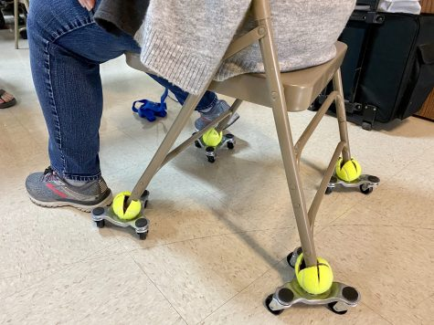 Clever hack: furniture movers from Harbor Freight and tennis balls elevate your chair just the right amount, and roll you wherever you need to go!