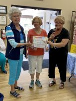 Hosts with the most! Hilda (left) and Peg (middle), accept certificate of appreciation from AZB4K President, Letty Fowell