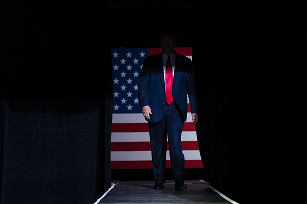 In this June 20, 2020, file photo President Donald Trump arrives on stage to speak at a campaign rally at the BOK Center in Tulsa, Okla. (AP Photo/Evan Vucci, File)