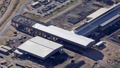 Ariel view of CMC crane building and roofing being finished