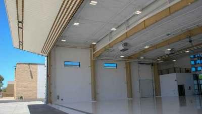 Bi-fold door opened, back view of the Triple C hanger at the Scottsdale Arizona Airport