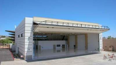 Ariel view of Triple C Hanger bi fold door open at the Scottsdale Airport in Arizona