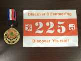 Medal and race bib.