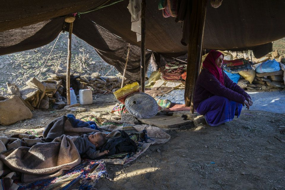 Mohamed sleep next to his mother Aicha, under a tente where they stay until mid September.