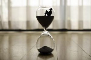 An hourglass with a man inside