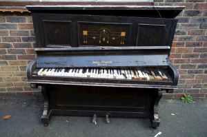 A damaged upright piano.