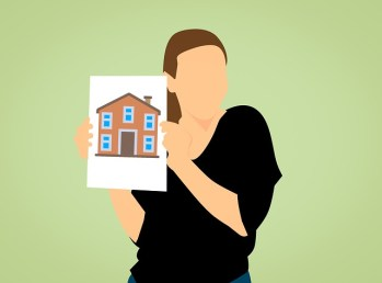 Woman holding a picture of a home