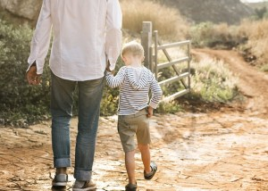 Father and son walking.