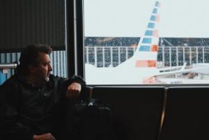 A man feeling homesick at an airport.