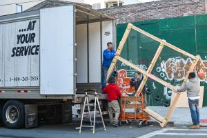 an image of movers loading a truck to move from Arizona to Washington