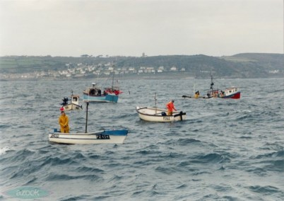 Newlyn 'Toshers' hand-lining for winter mackerel in November 1998. The weather is unsettled with a loppy sea but are close to home. Paul church tower is in the background and they are only a mile from Newlyn. (© Glyn Richards. GRC_1_01)