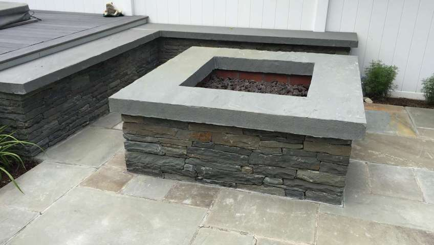 One piece blue stone coping for this fire pit New Paltz NY