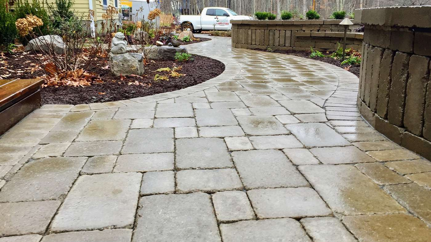 Unilock Brussels Pavers for a curve walkway with landscape in New Paltz NY