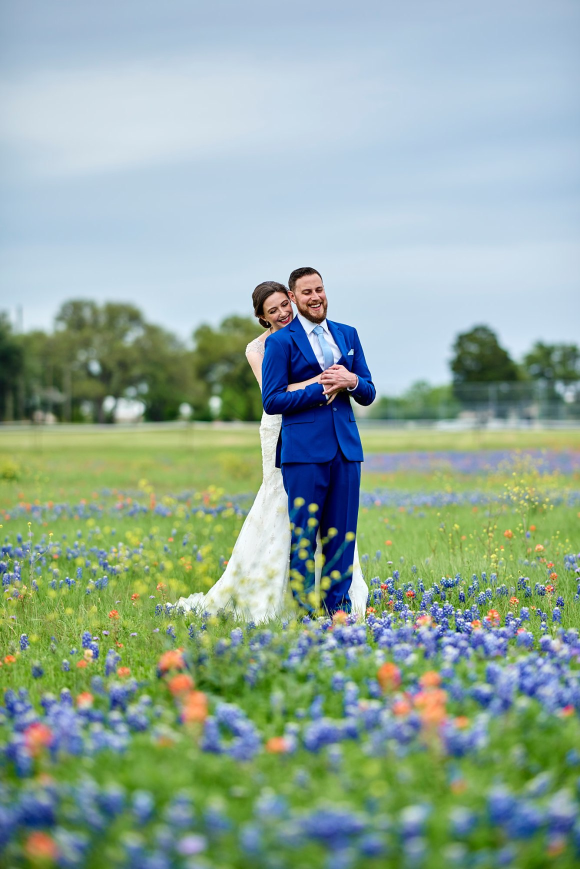 Blue Bonnet First Look - Waco DIY Wedding - Temple Camp Wedding - Hallie and Jonathan - Green Family Camp - Blue Bonnet Wedding