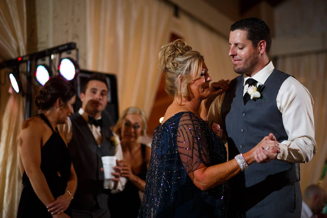 Antebellum Oaks Wedding - Austin Wedding Photographer - Jacob and Katie - hill country wedding - groom dancing with mother in law - fun wedding reception -