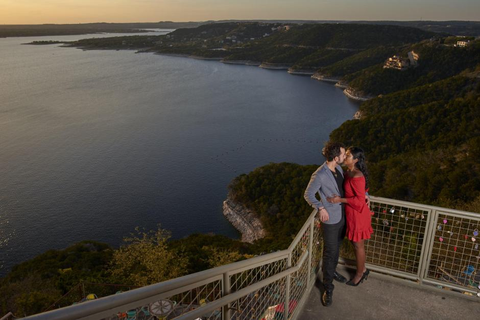 Austin Engagement Photos - A Kiss at Sunset over Lake Travis at the Oasis