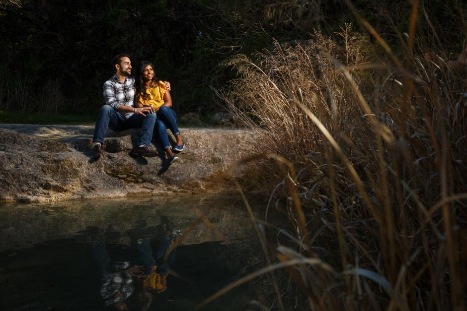 Austin Engagement Photos at Enchanged Rock - Couple reflected in a small pond.