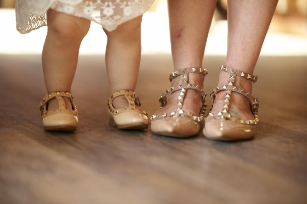 Katie and her daughter have matching spiky shoes.