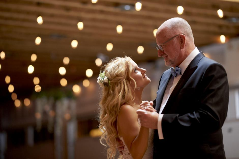 Father daughter dance in the barn.