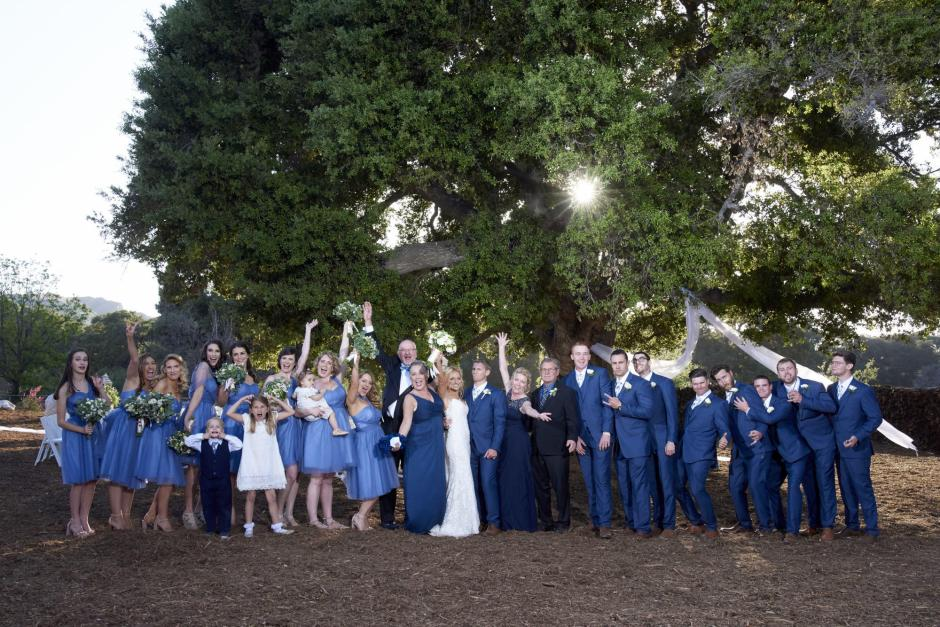 Big group formal portrait during the golden hour wedding. It's a new combined family!