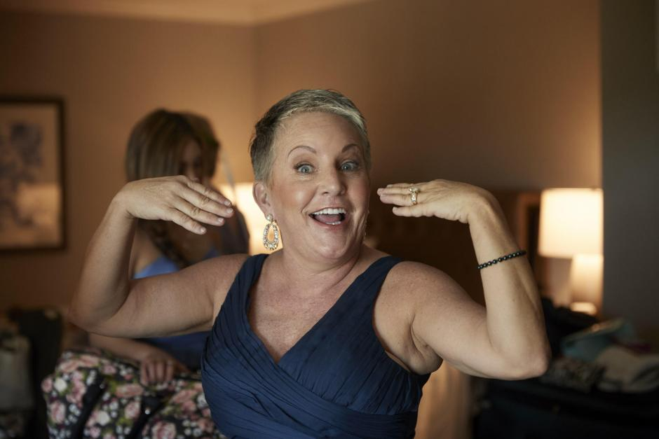 Mom is excited while the bride gets ready.