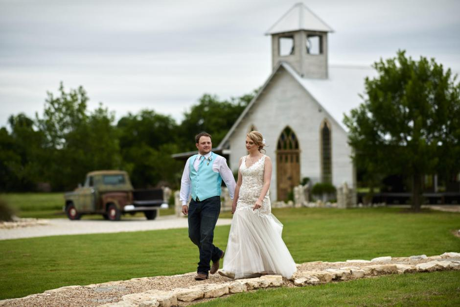 Amber and Luke walk from the chapel to the reception at Gruene Estates.