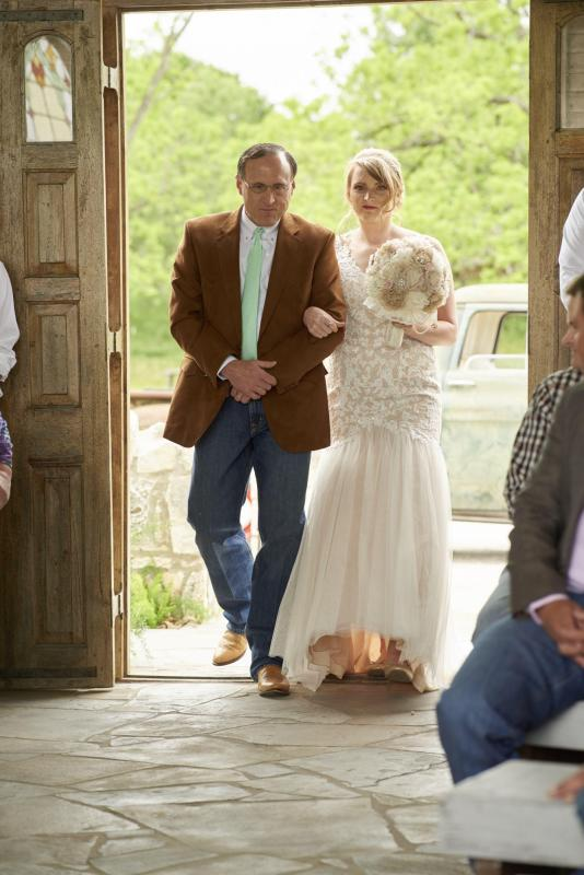 Bride enters Gruene Estate's chapel with her father.