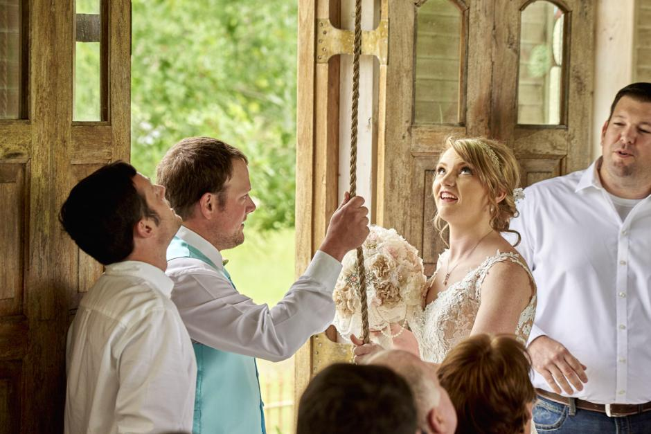 Amber and Luke ring the Gruene Estate Chapel bell after their ceremony.