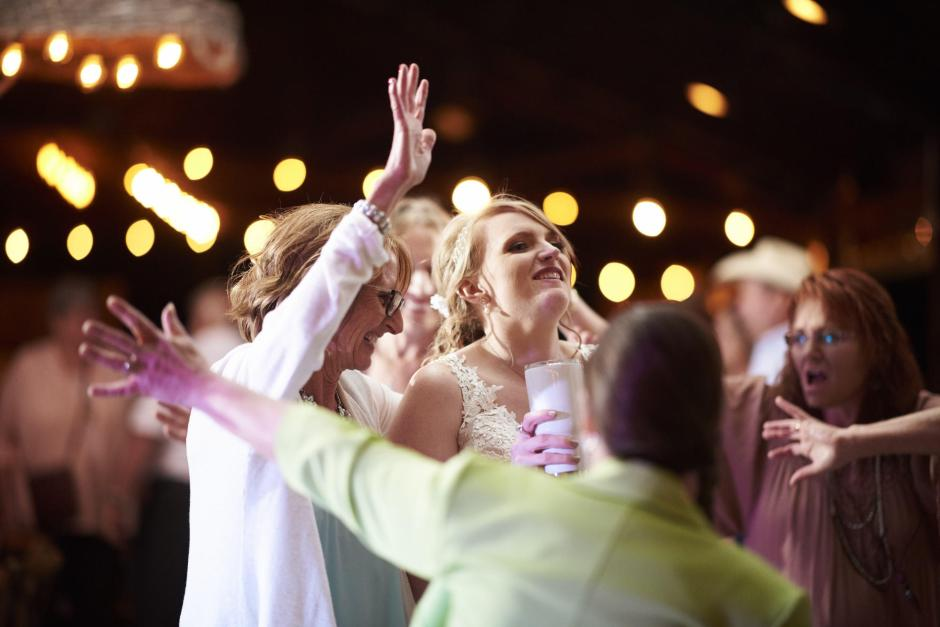Bride dancing with her friends and family.